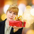 Businesswoman gives gifts — Stock Photo