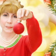 Merry Christmas - woman with red bauble — Stockfoto