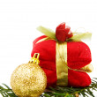Christmas golden bauble and gifts - Stock Photo