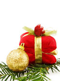 Christmas golden bauble and gifts — Stock Photo