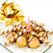 profiteroles avec bougie festive — Photo #1430677