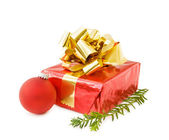 Christmas festive gifts and red bauble — Stock Photo