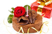 Birthday cake with red rose and gift — Stock Photo