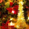 Magic Christmas candle and golden tree - Stock Photo
