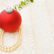 Christmas red bauble with vintage pearls — Stock Photo