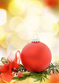 Christmas festive card with red bauble — Stock Photo