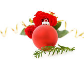 Christmas red bauble and roses — Stock Photo