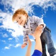 Flying child on sky — Stock Photo