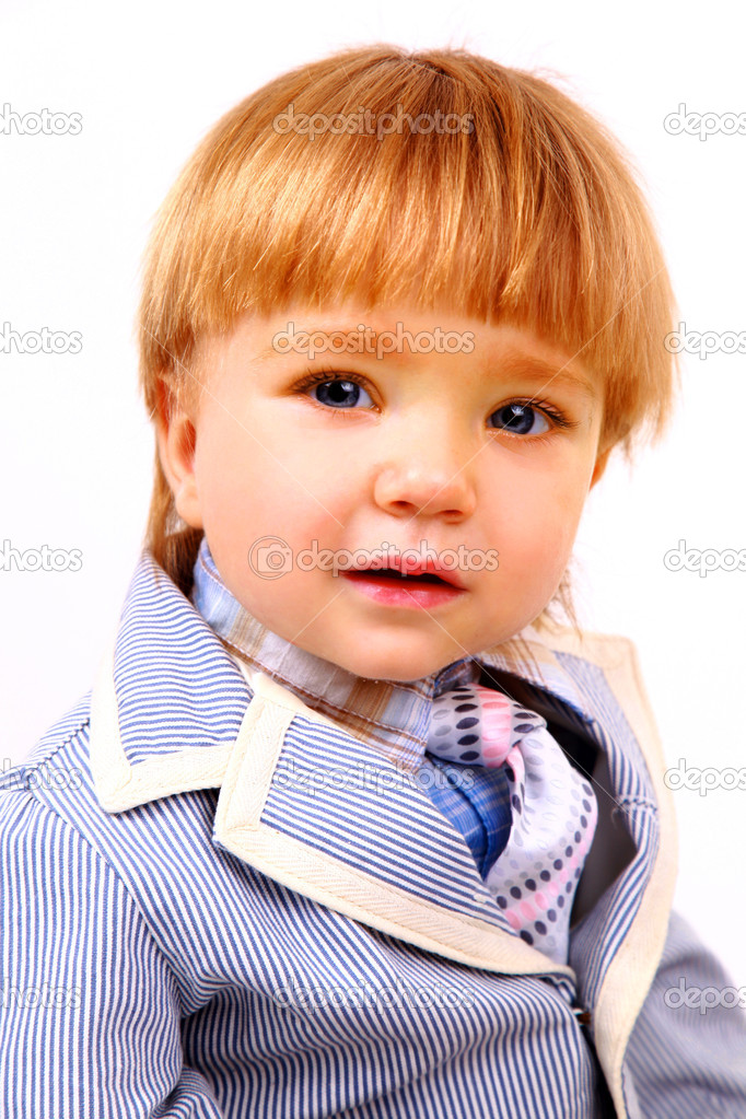 Photo of adorable young boy looking at camera  Stock Photo #1138300