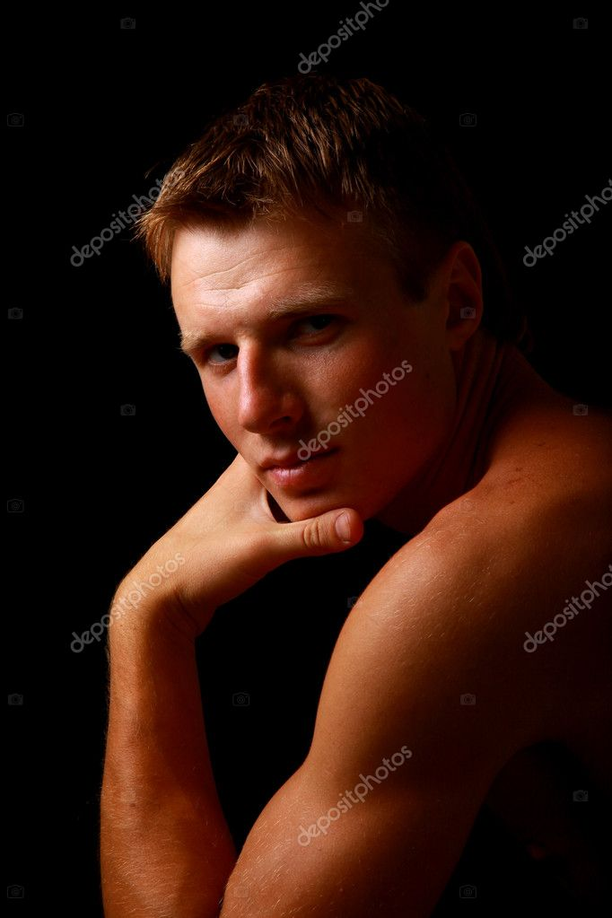  Shadowy dark close-up portrait of young good looking male model  Stock Photo #1139781