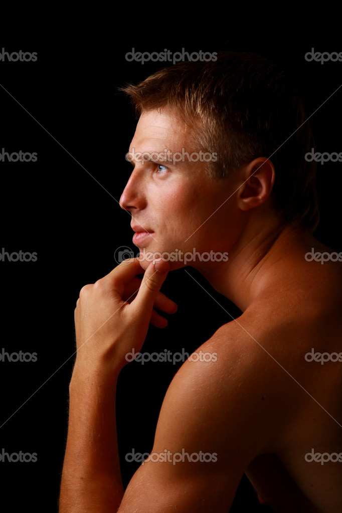 Shadowy dark close-up portrait of young good looking male model — Stock Photo #1139801