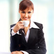 Businesswoman working at desk - Stock Photo