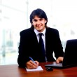Businessman sitting by desk — Stock Photo #1148147