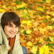 Man on autumn background — Stock Photo