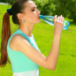 Royalty-Free Stock Photo: The young woman drinks water