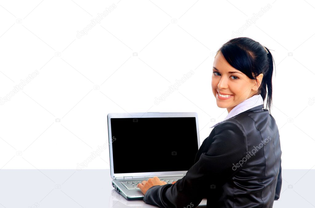 Young woman is lying on the floor and working on a laptop  Stock Photo #1140272