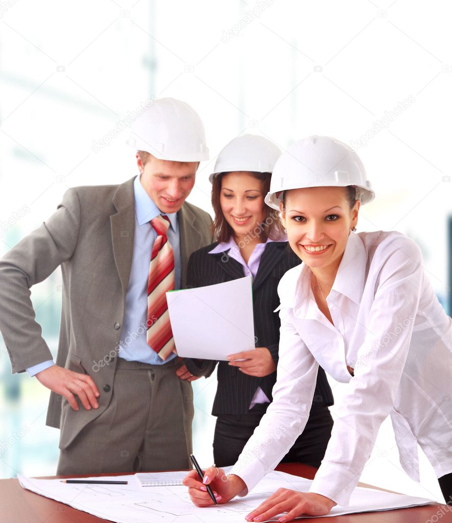 A group of architects discussing the plans for a new building — Stock Photo #1142136