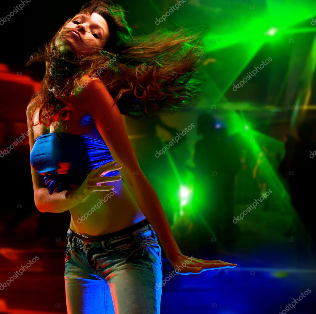 Beautiful young woman dancing in the nightclub — Stok fotoğraf #1142938