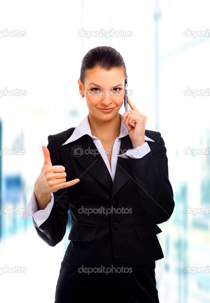 Young woman calling by cellular phone  Stock Photo #1143699