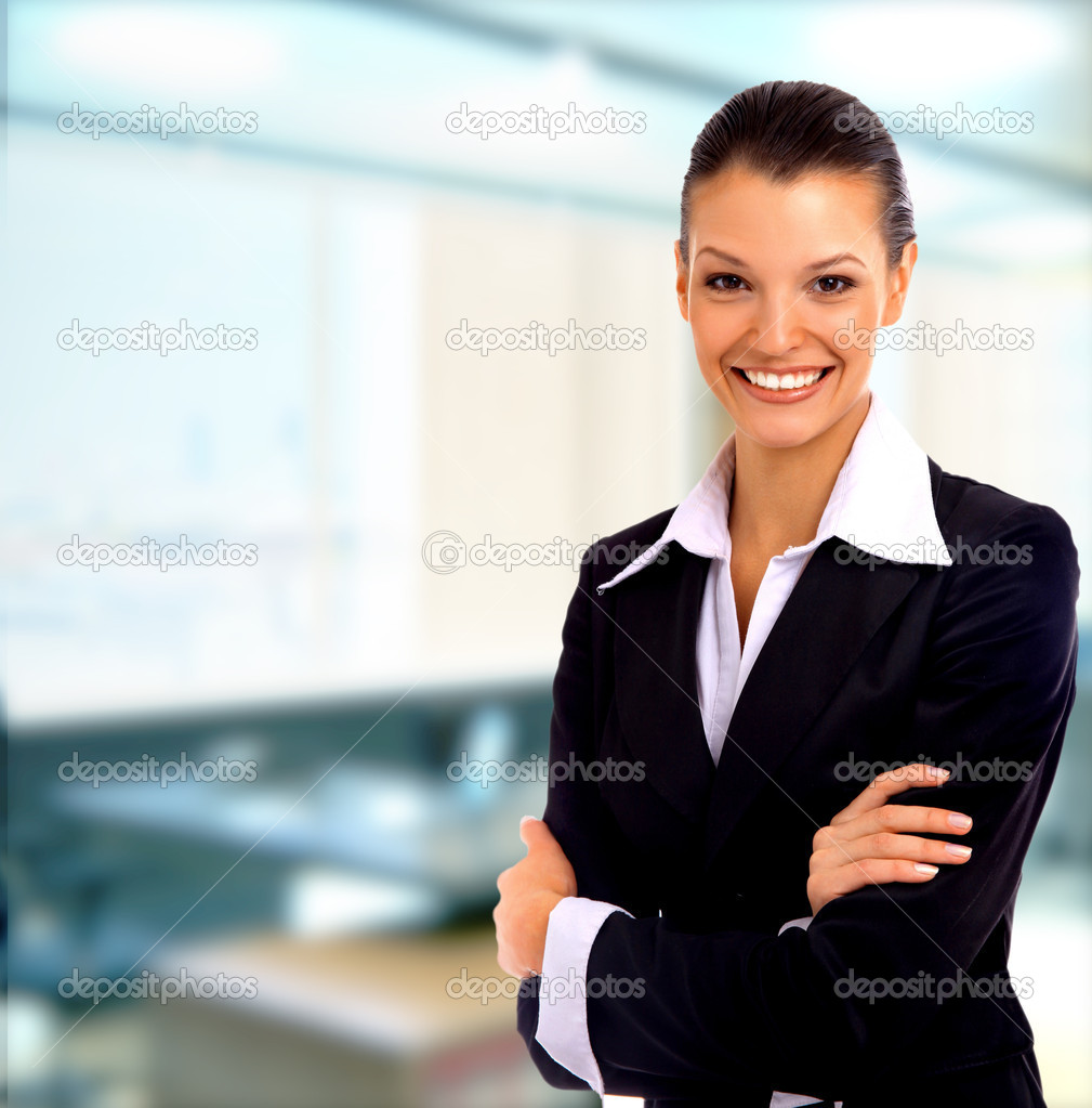 Positive business woman smiling over white background   #1144038