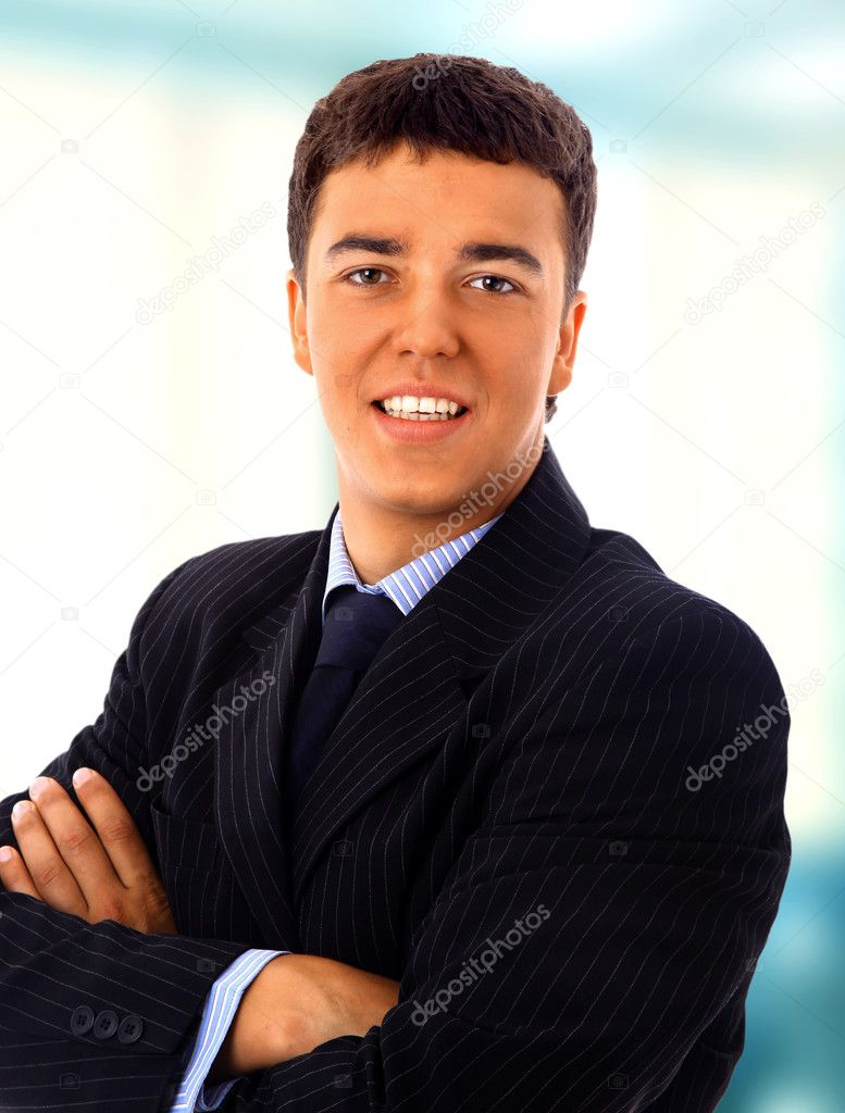 Young businessman in hall of a modern office building. — Stock Photo #1144078