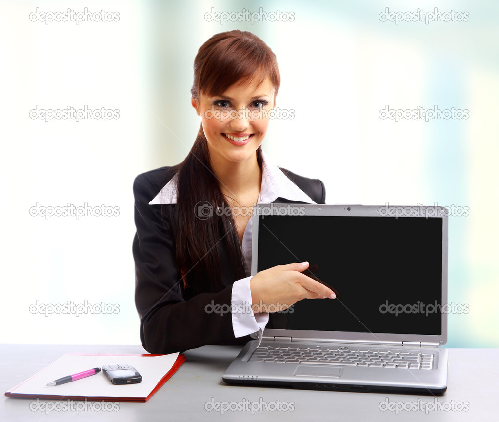 Pretty business woman looking at laptop  Stock Photo #1147683