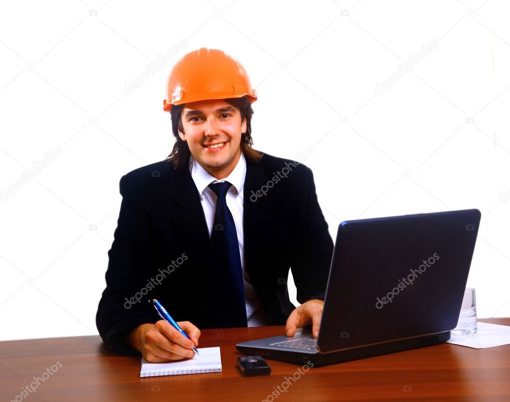  Construction contractor in the office on his laptop. Isolated on white.  Stock Photo #1148135