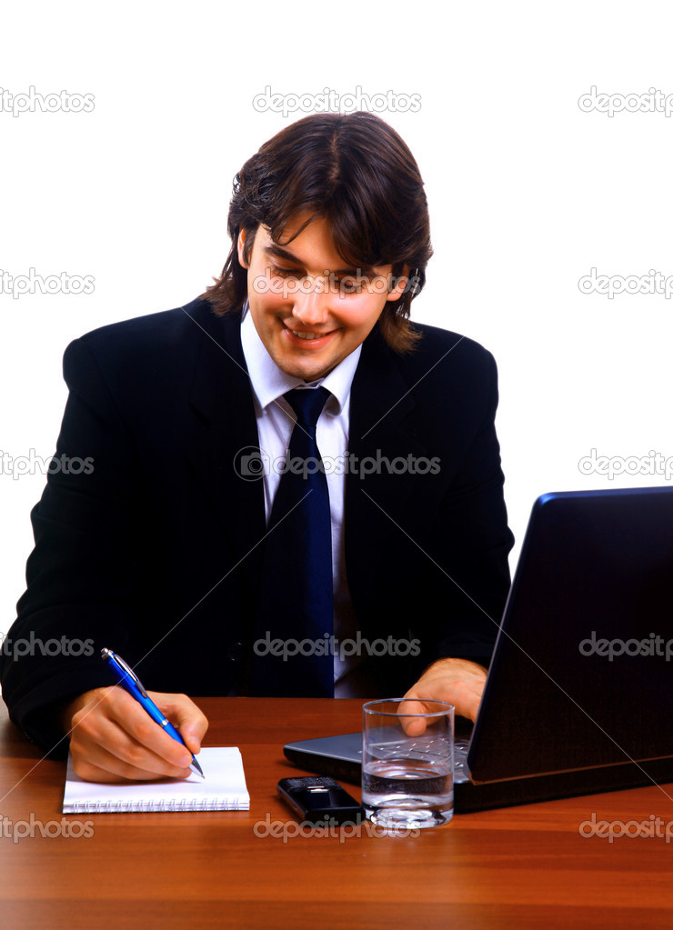 Businessman sitting by desk at office working on the laptop — Stock Photo #1148165