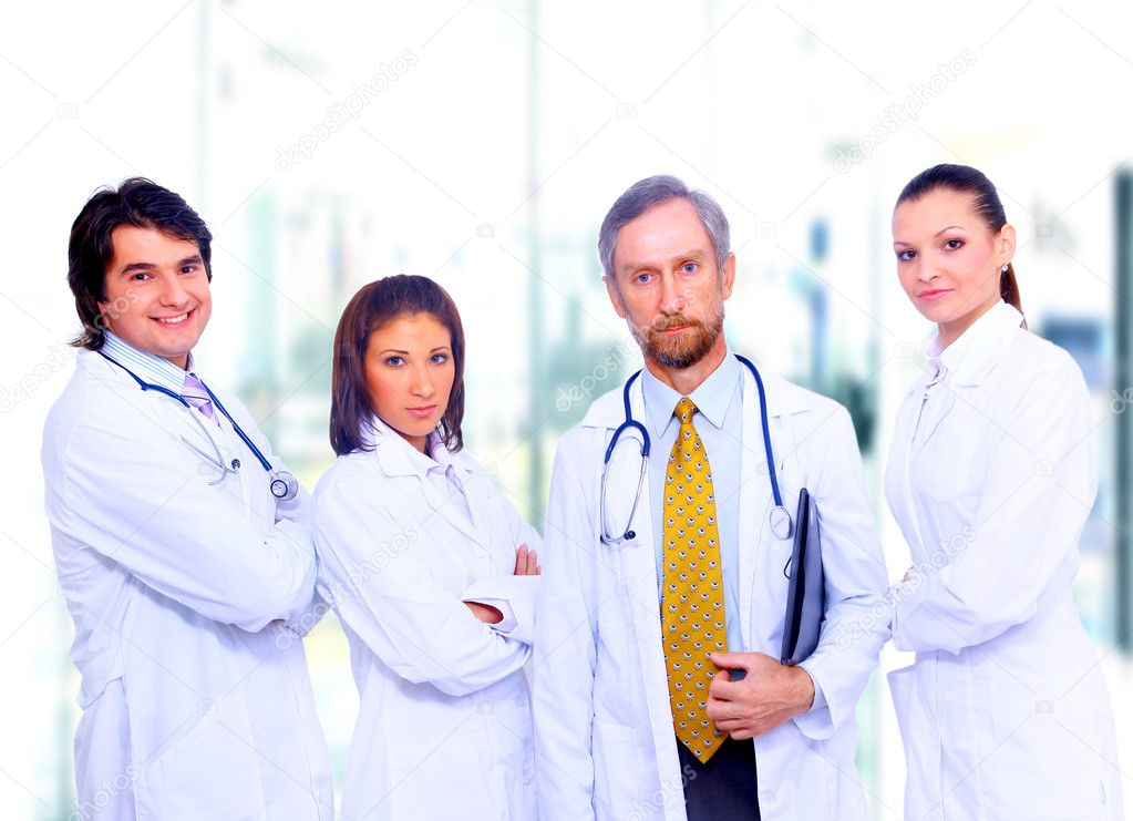 Portrait of group of smiling hospital colleagues standing together — Stock Photo #1148629