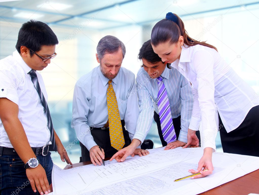 Business men and women working on blue prints — Stock Photo #1148681