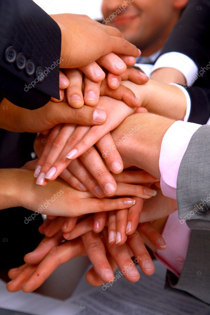 Group of business making a pile of hands in a light and modern office environment — Stock Photo #1148758