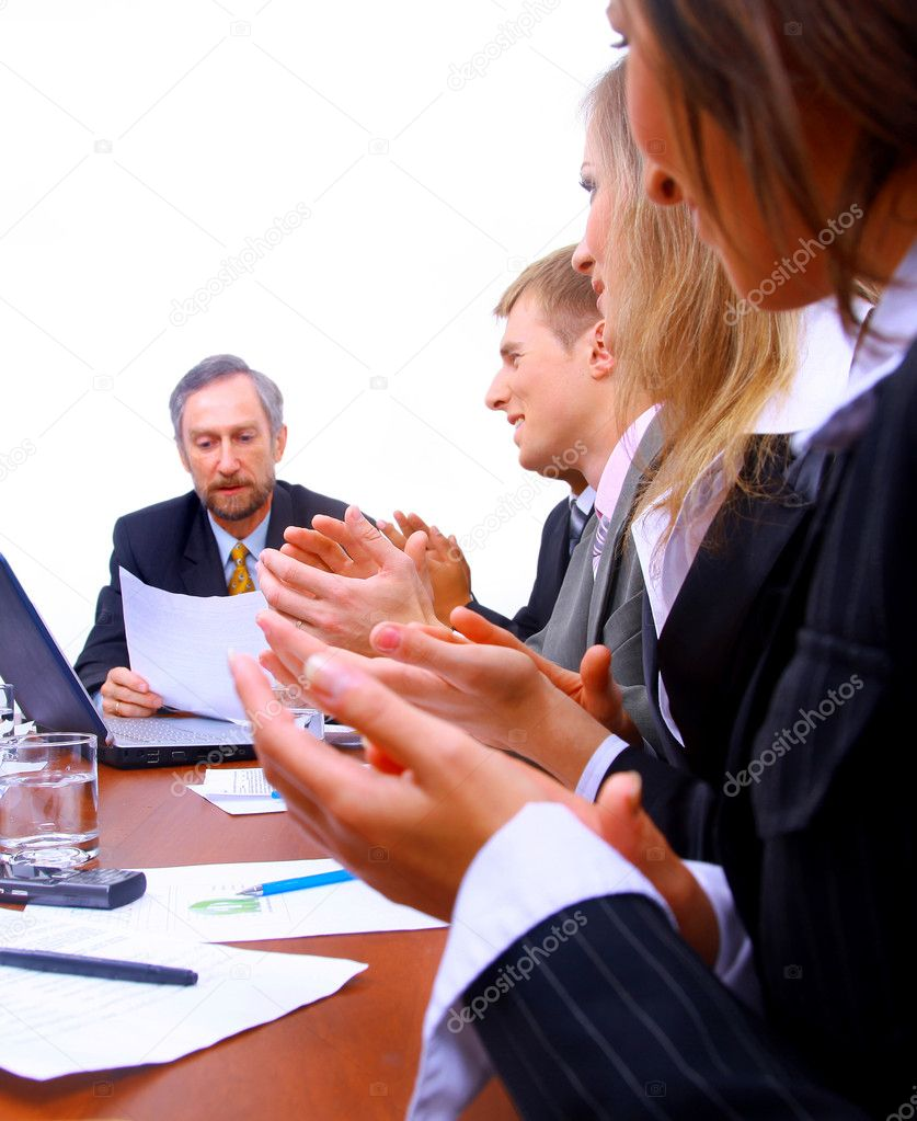 Happy business team applauding together  Stock Photo #1148811