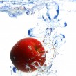 Red apple under water - Stock Photo