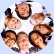 Group of business standing in huddle, smiling, low angle view — Stock Photo #2529478