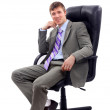 Young businessman sitting on chair — Stock Photo
