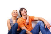 Young love smiling couple in the new flat — Stock Photo