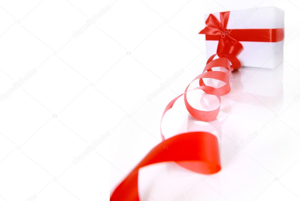 gift wrapped with a red ribbon on a white background — Stock Photo #2529809