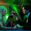 Young pair in the disco — Stock Photo