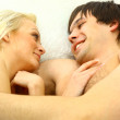 Young couple having fun in the bedroom — Stock Photo