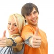 Portrait of a young teenage couple smiling against white background — Stock Photo #2533241
