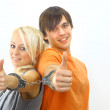 Portrait of a young teenage couple smiling against white background — Stock Photo