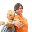 Portrait of a young teenage couple smiling against white background — Stock Photo #2533266
