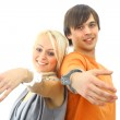 Portrait of a young teenage couple smiling against white background — Stock Photo #2533288