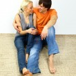 Stock Photo: Young love smiling couple in the new flat