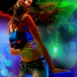 Young woman dancing in the nightclub — Stok fotoğraf