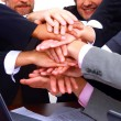 Stock Photo: Group of business making a pile