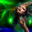 Stock Photo: Beautiful young womdancing in nightclub