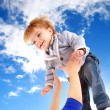Flying child on sky background — Stock Photo