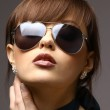 Beautiful woman in the black fashion sunglasses — Stock Photo #2536076
