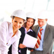 A group of architects discussing the plans for a new building — Stock Photo #2536529
